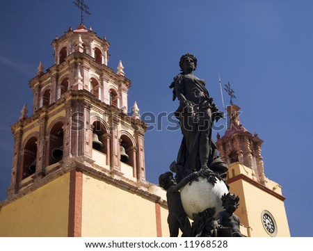 Peace Statue Donated To City by Charles V, Holy Roman Emperor, in the 1500s, Steeple, Towers, Bells, Basilica of our Lady of Guanajuato, Basilica de Nusetra Senora Guanajuato, Mexico