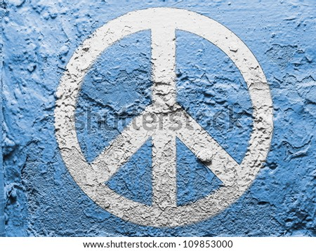 Peace symbol painted on grunge wall