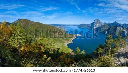 Peaceful autumn Alps mountain Traunsee lake view from Kleiner Sonnstein rock summit, Ebensee, Upper Austria.