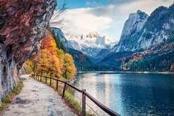 Peaceful autumn scene of Vorderer ( Gosausee ) lake with Dachstein glacieron background. Picturesque morning view of Austrian Alps, Upper Austria, Europe. Traveling concept background.