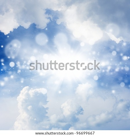 Peaceful background - bright sun, blue sky, white clouds - heaven