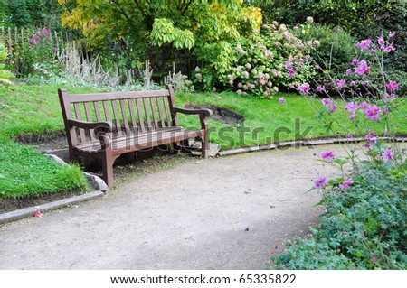 Peaceful Garden Scene with a Gravel Walkway and Wooden Bench