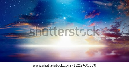Peaceful heavenly background - way to heaven, bright light from heaven door, stars and glowing clowds above serene sea