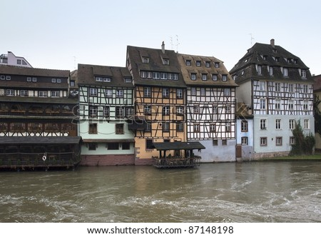 peaceful idyllic scenery in Strasbourg with timbered houses waterside (Alsace/France)