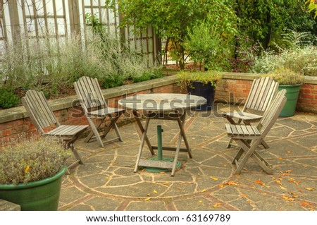 peaceful inviting image of english country garden with furniture and vibrant autumn fall colors autumn furniture