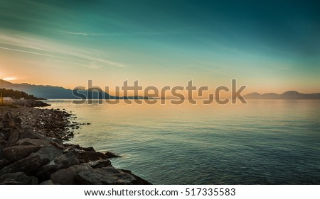 Peaceful landscape with sea and hills before sunrise. South Europe, Croatia - idyllic morning view from Hvar island.  #517335583