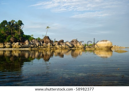 peaceful morning reflection on belitung indonesia