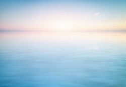 Peaceful pastel scene of a calm water surface. Element of backgriund design.