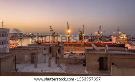 Peaceful sunrise at the port of Sfax, Tunisia.  Sfax is Tunisia's second largest city, a major port and home to Tunisia's largest fishing fleet.  #1553957357