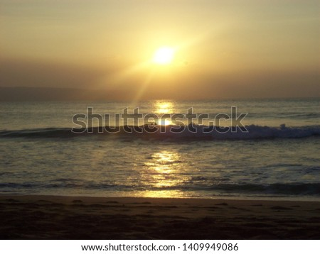 Peaceful sunset and tranquil waves #1409949086