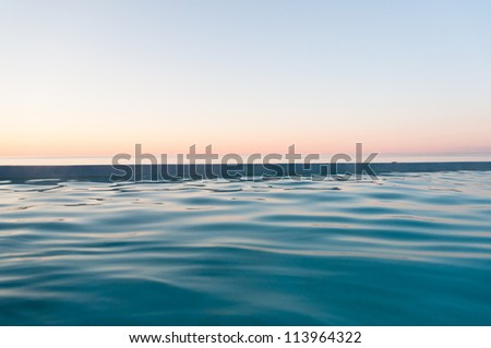 peaceful sunset at sea in soft, pastel colors #113964322