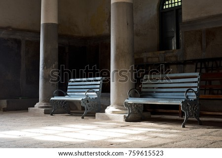 peaceful view of two benches in ...
