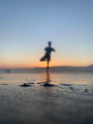 Peacefull mindifulness man in the beach at summer sunset in praia da Boraceia Bora Bora Brasil (boraceira beach bora bora brazil)