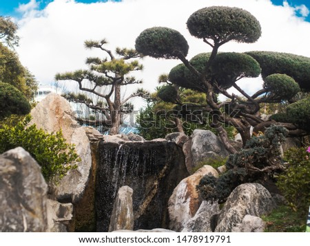 peacefull oriental landscape with trees waterfall and stones #1478919791