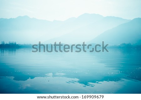 Peacefully Dal lake with snow mountain background in Srinagar, Kashmir India  #169909679