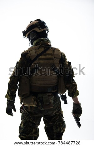Peacemaker wearing in military uniform while holding gun. Protection concept. Isolated