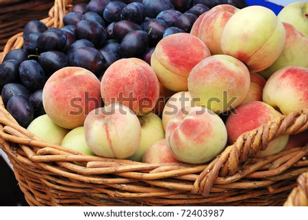 peach and plum crop in a basket