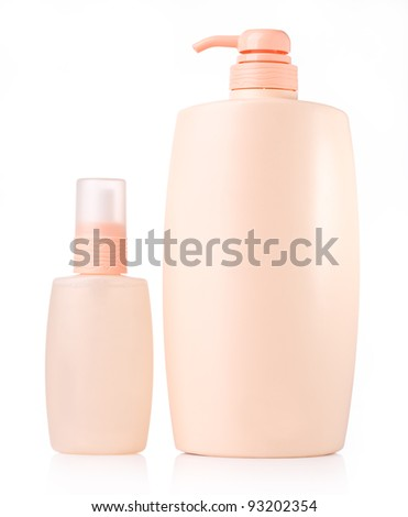 peach cosmetic bottles - pure group of isolated - stock photo