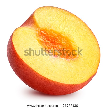 Peach half isolated on white background. Peach fruit clipping path. Peach macro studio photo