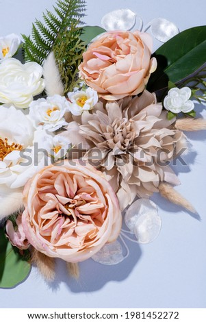 Peach Pink and White Faux Flowers on Pastel Blue Background Photo stock ©