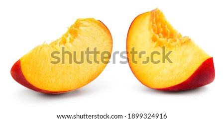 Peach slice isolate. Peach on white background. Sliced peach isolated. With clipping path.