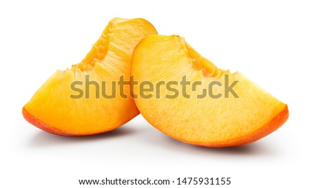 Peach slice isolated. Peach on white background. Sliced peach. With clipping path.