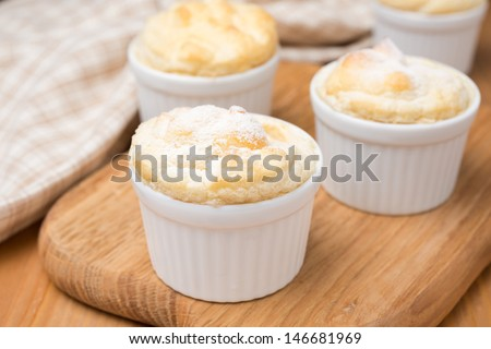peach souffle in the portioned form on a wooden board, close-up