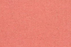 Peach textured cardstock paper closeup background with copy space for message or use as a texture