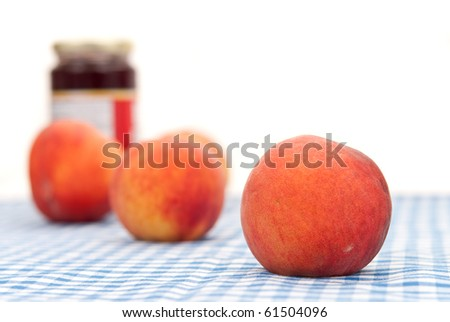 Peach with Out of Focus Peaces and Peach Jam Jar in Background