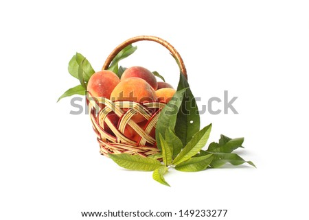 Photo of peaches in a basket isolated on white