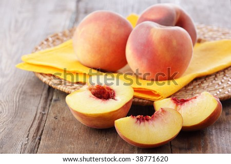 Peaches on a straw plate