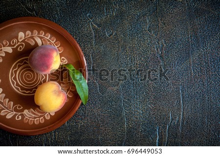 peaches on plate on a vintage...