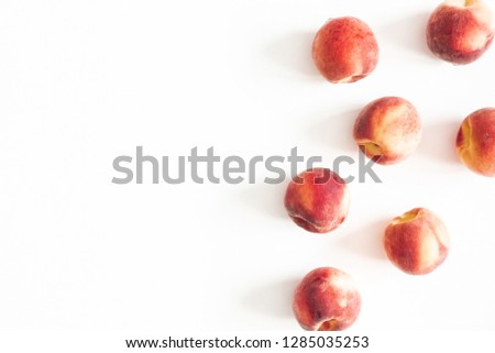 Peaches on white background. Flat lay, top view, copy space #1285035253