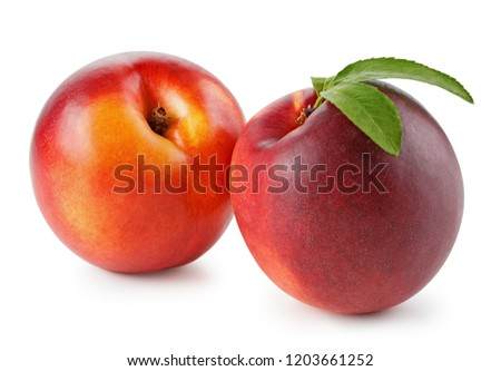 Peaches or nectarines with leaf isolated on white background