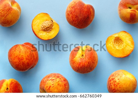 Peaches pattern. Top view of fresh fruits on a blue background. Repetition concept #662760349