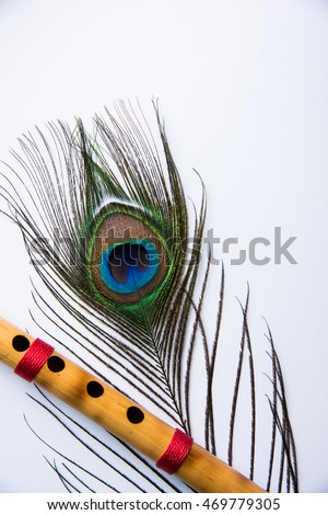 free photos peacock feather and bamboo flute over colourful