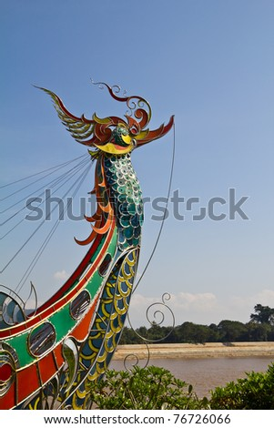 Peacock sculpture on the prow of boat (Golden Triangle, Chiangrai, Thailand).