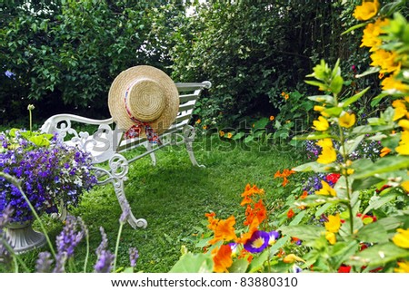 Peacuful summer garden with a hat
