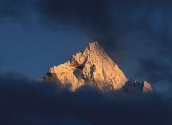 Peak of mount Ama Dablam at sunset.
