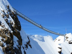Peak walk on the Suspension bridge between two mountain peaks (Travel destination Glacier 3000) or Peak walk sur le pont suspendu, Les Diablerets - Canton of Vaud, Switzerland (Suisse)