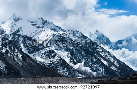 Peaks and glacier in Himalayas not far Gorak shep and Everest base camp - stock photo