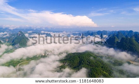 Peaks in clouds and mist