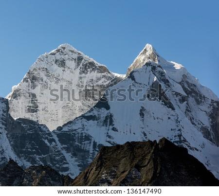 Peaks Kantega (6783 m) and Thamserku (6608 m) from Teshinga village - Everest region, Nepal, Himalayas - stock photo