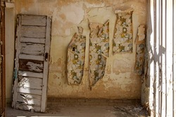 Pealing Wallpaper in dilapidated school house