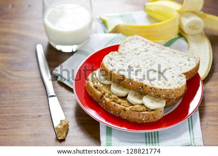 Peanut butter and banana sandwich with glass of milk