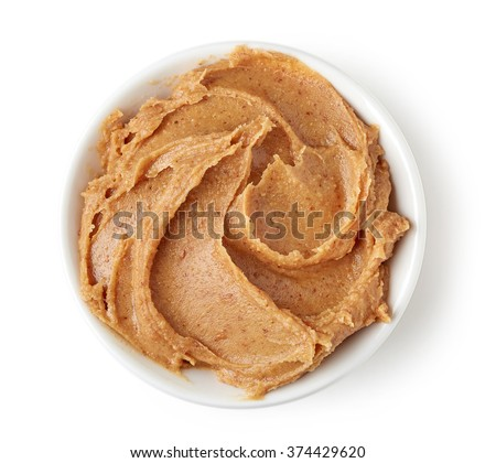 Peanut butter in round dish isolated on white background, top view Stock photo ©