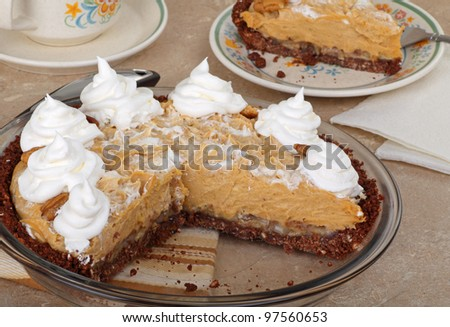 Peanut butter pie with whipped cream in a pie plate