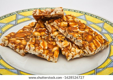 Peanut chikki or peanut brittle is a delicious candy. Easy to made at home. It is a traditional sweet preparation across India, usually made by jaggery and peanuts or ground nuts blended together