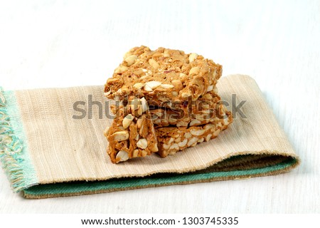 peanut chikki, sesame candy and roasted groundnuts - Image