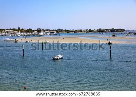 Peanut Island North Sandbar in Riviera Beach, Florida, is a popular boating destination to beach a boat at low tide and walk on the sandbar, and meet with friends, as well as letting your dog run. #672768835